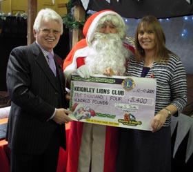 Tanya Smith presents a cheque to Keighley Lions